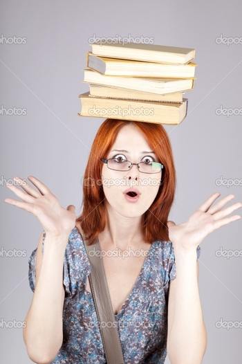 depositphotos_3463916-red-haired-girl-keep-books-on-her-head.-studio-shot.