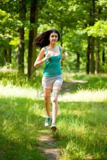 5188480-beautiful-young-woman-running-or-jogging-through-a-forest-healthy-life-and-sport-concept