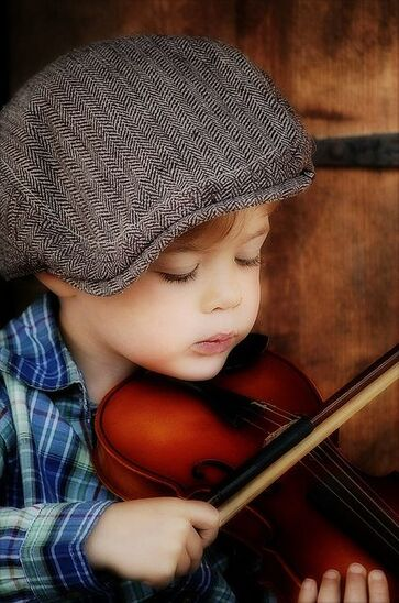 Reminds me of my sons when they started to learn the violin at the age of four at the Conservatorium of Music under Magda Hammond