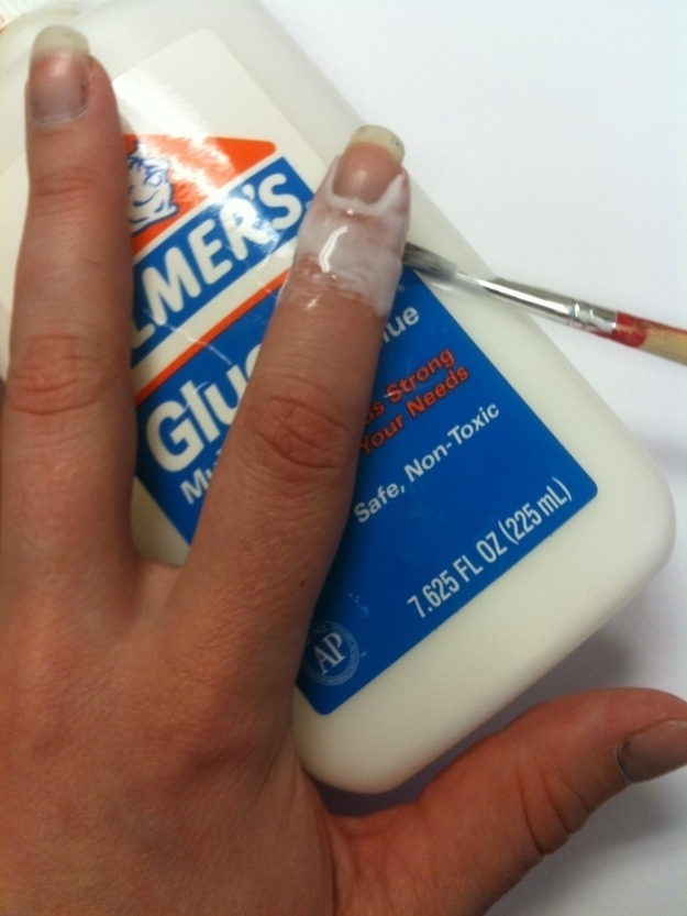 Apply Elmer's glue with a thin paint brush, which peels off to reveal a perfect manicure.