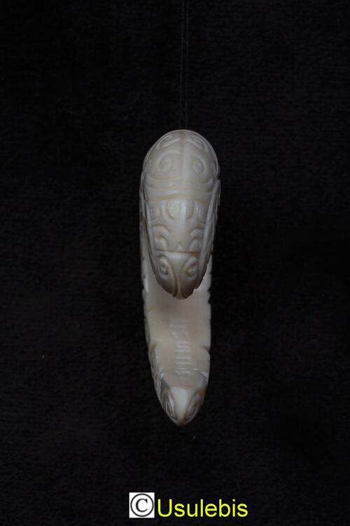 Imitation écarteur Tiki en os