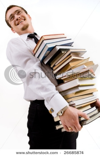 stock-photo-handsome-young-man-holding-stack-of-books-26685874