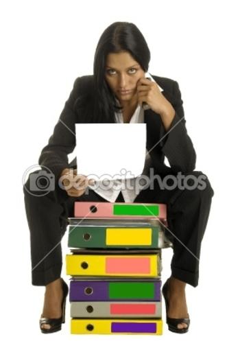 dep_1615955-woman-is-sitting-on-the-binders