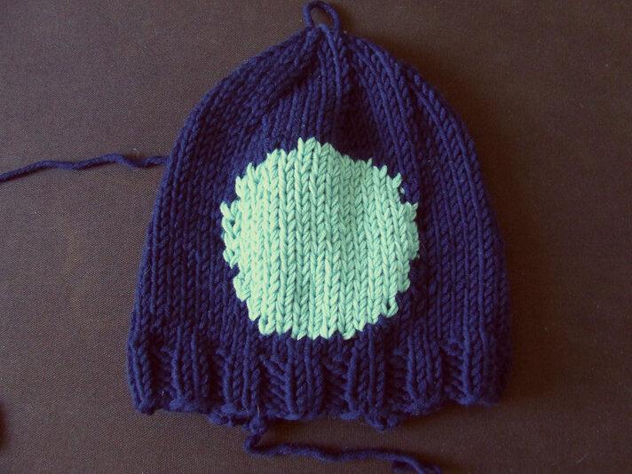 Le bonnet en jacquard intarsia
