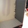 la mise en place du décor: plancher et mur de la terrasse