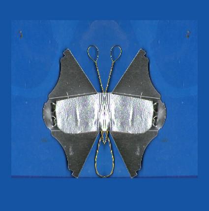 Réalisation d'un papillon . papillon prêt pour les paillettes