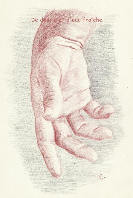 Main au crayon de couleur sur papier croquis ivoire