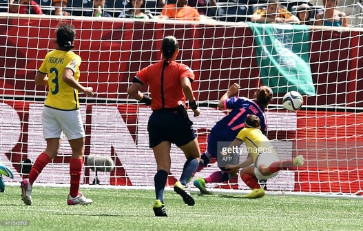 Japan's forward Yuki Ogimi (#17) scores against Ecuador at the Winnipeg Stadium during their Group C football match of the 2015 FIFA Women's World Cup in Winnipeg, Manitoba on June 16, 2015. AFP PHOTO/JEWEL SAMAD