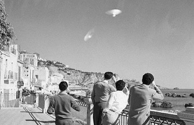 Four Sicilian men watch two unidentified objects over Sicily on December 10, 1954