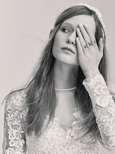 "This pic is from the Elie Saab Bridal collection. In this image, the model is saying ""Oui"" (yes) with the one-eye sign. Is she getting married to someone ... or the occult elite?"