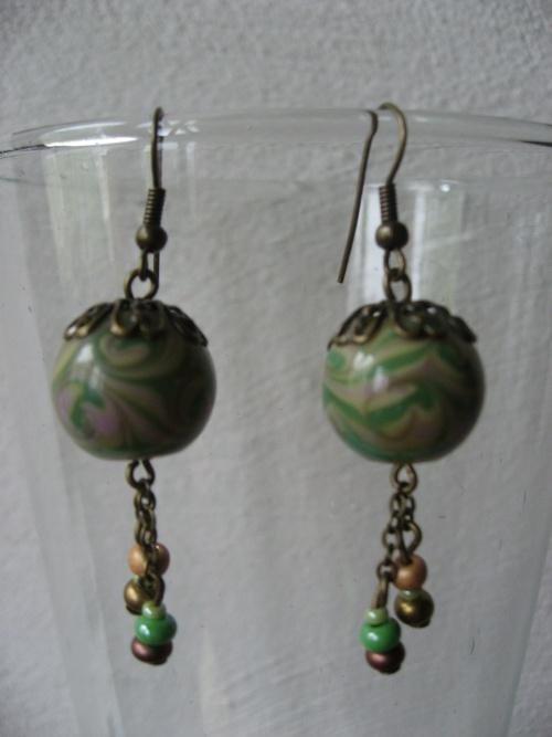 Un peu de temps pour habiller ces perles, mais j'aime le résultat