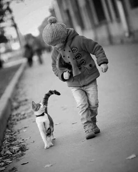 A kid and a cat. #Photo #Photography #Blackandwhite #Kid #Child #Cat #Fun #Silly #Happy #Friends