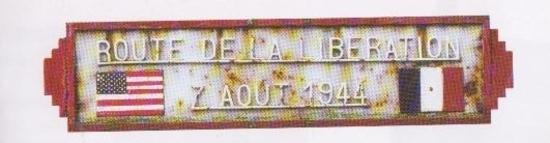 Plaque en fonte apposée au début de la route de la Libération jusque dans les années 90.