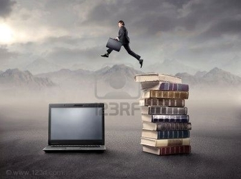 8054402-businessman-jumping-froma-stack-of-books-on-a-laptop