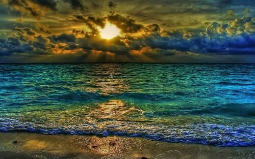 Couchés de soleil à la mer