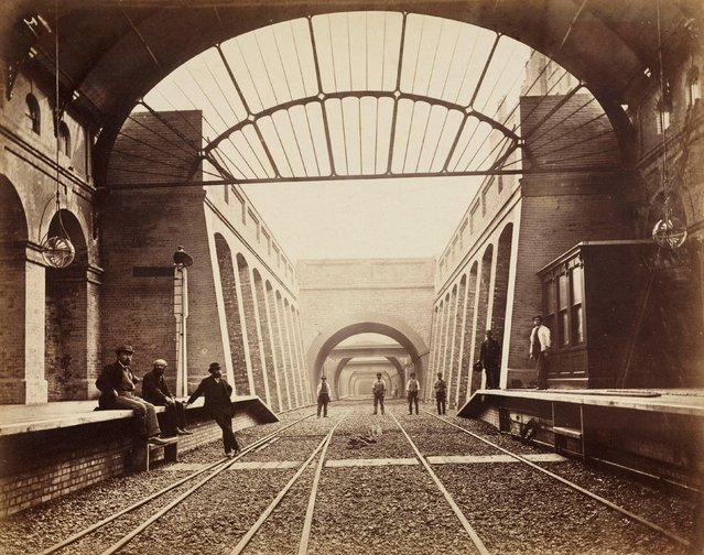 "One of a series of photographs by Henry Flather showing the construction, undertaken between 1866 and 1870, of the Metropolitan District Railway's (MDR) underground lines between Paddington and Blackfriars via Kensington. It shows Notting Hill Gate Station shortly before it opened in 1868. The line laid by the MDR from the 1860s onwards was designed to provide a rail connection for travellers between London's mainline railway terminals, situated in a ring around the city centre. It now forms part of the existing District and Circle Lines on the London Underground. The construction work, utilising the ""cut and cover"" technique, caused much disruption to London neighbourhoods. (Photo by SSPL/Getty Images)"