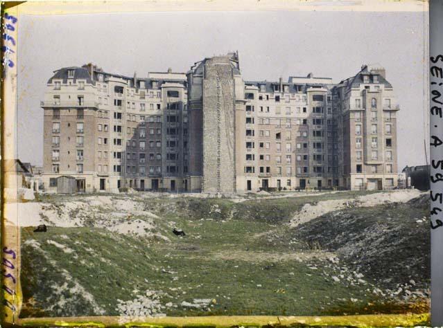 Démolition des fortifications et reconstruction d'immeubles (HBM), porte d'Orléans par Stéphane Passet ©Musée Albert-Kahn - Département des Hauts-de-Seine