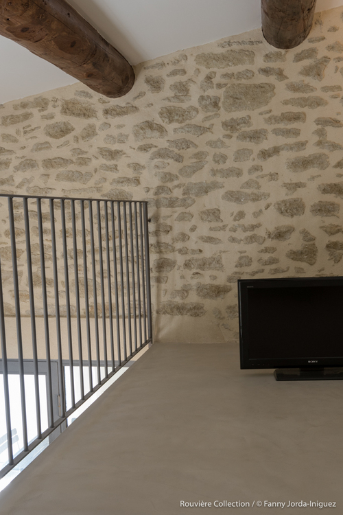 Agencement intérieur d'une grange rénovée par Rouviere Construction