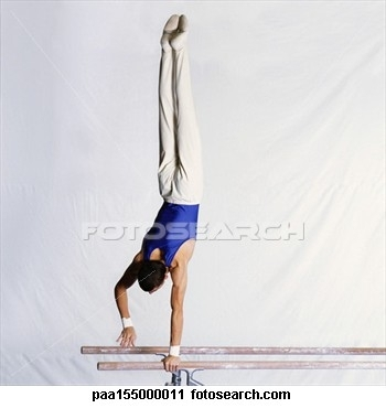 male-gymnast-performing_~paa155000011