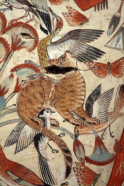 Chat chassant parmi les papyrus