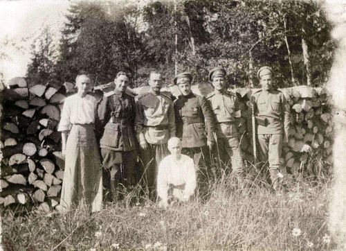 Grand Duchesses Tatiana and Anastasia with Nicholas II and some soldiers under house arrest at Tsarskoe Selo: June 1917.