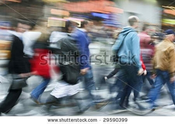 stock-photo-abstract-motion-blur-of-a-group-of-unrecognizable-faces-people-crossing-street-29590399
