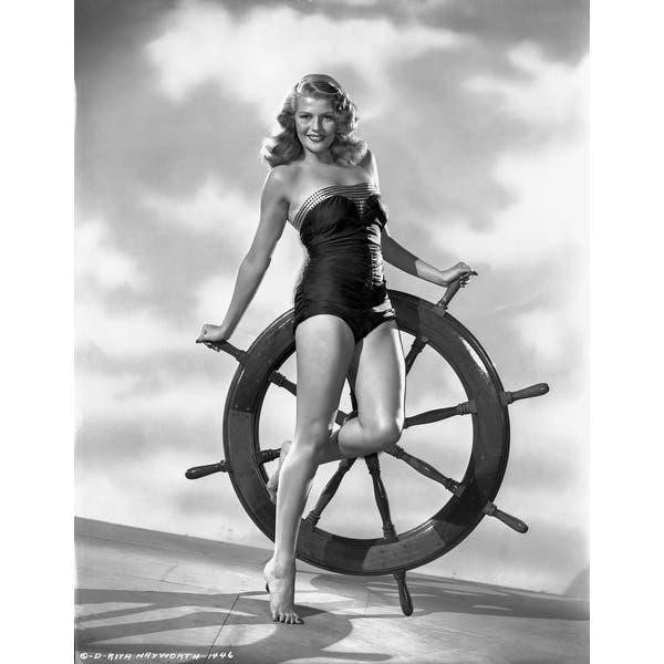 https://ak1.ostkcdn.com/images/products/is/images/direct/ed9f5e819f444593da75a7a44e523feeceb07eb9/Rita-Hayworth-in-Swimming-Suit-Photo-Print.jpg?impolicy=medium