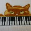Marie Claire un chat pianiste