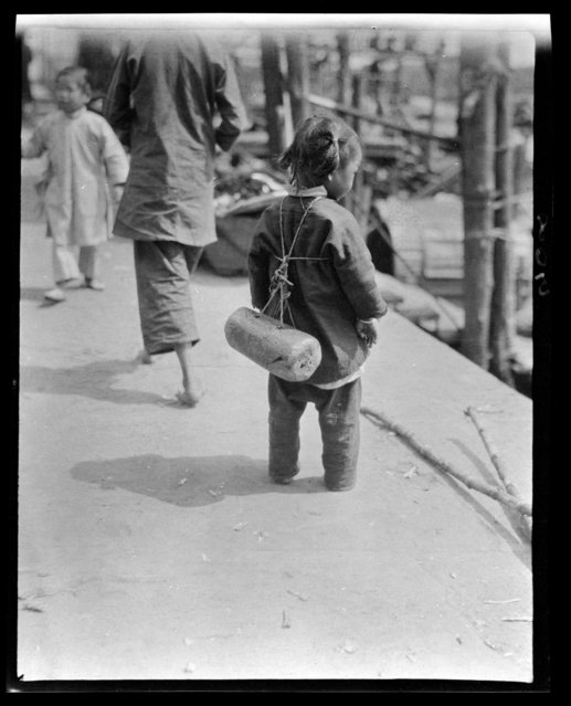 Child with Life Preserver. China, Guangzhou, 1917-1919. (Photo by Sidney David Gamble)