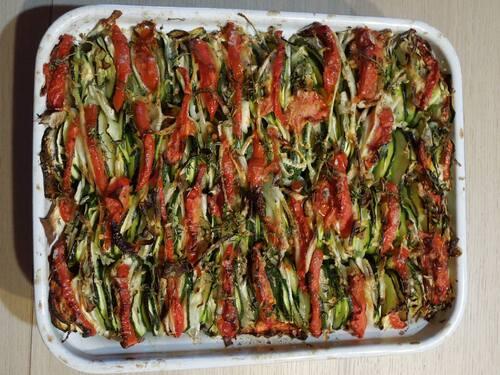 Tian courgettes/fenouilsl/tomates/oignon huile de truffe sur lit de pilpil.