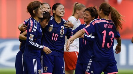 Aya Miyama of Japan (2nd L) is congratulated after scoring from the penalty spot