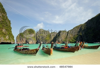 stock-photo-thailand-andaman-sea-phi-phi-island-thai-boats-on-maya-bay-lagoon-48547984