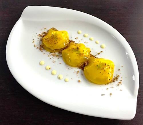 Ravioles de mangue, crabe, granit smith et sa mousse de fenouil.