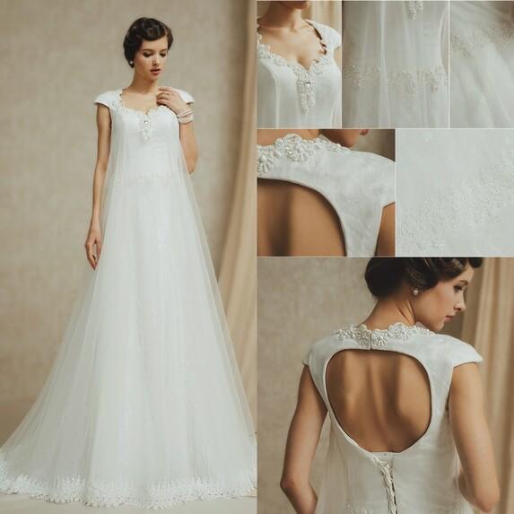 robe de mariée sirène dos ouvert perlé en dentelle avec manche courte