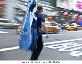 stock-photo-musician-carrying-instrument-in-the-case-intentional-motion-blur-54326404