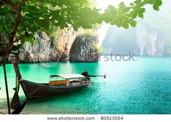 stock-photo-long-boat-on-island-in-thailand-80513554