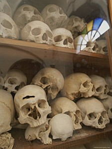human-skulls-fill-a-display-case-at-nea-moni-monastery