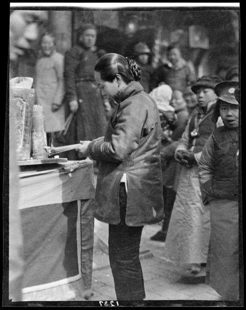 New Year's worship, Woman lighting Incense. China, Baoding Fu, February 1, 1919. (Photo by Sidney David Gamble)