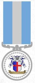Babou Chkaya reçoit la médaille du gouvernement de Surland.