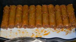 Cannellonis farci au boeuf, féta nappé de sauce tomate saupoudré de parmesan et mozza
