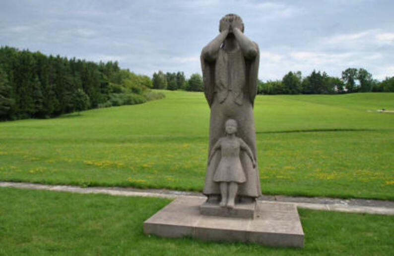 The statue of a crying lady with a child - overlooking the area that was once the village of Lidice - is a part of the Lidice Memorial.