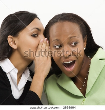 stock-photo-indian-young-adult-woman-whispering-in-ear-of-mid-adult-african-american-woman-2838984