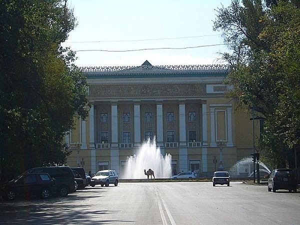 in front of Abay Opera and Ballet Theater in Almaty