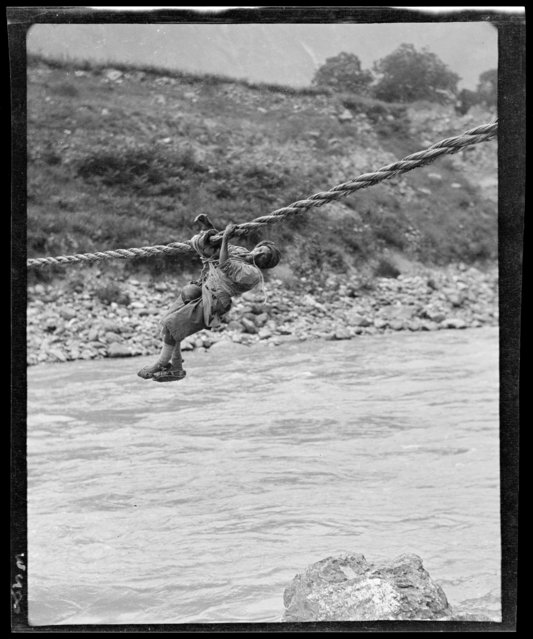 Man on Rope Bridge. China, Zagunao, 1917-1919. (Photo by Sidney David Gamble)