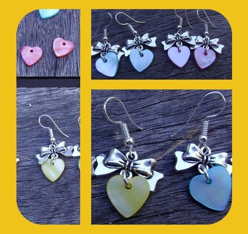 Boucles d'oreilles fantaisie coeur en nacre avec leurs noeuds métallisés