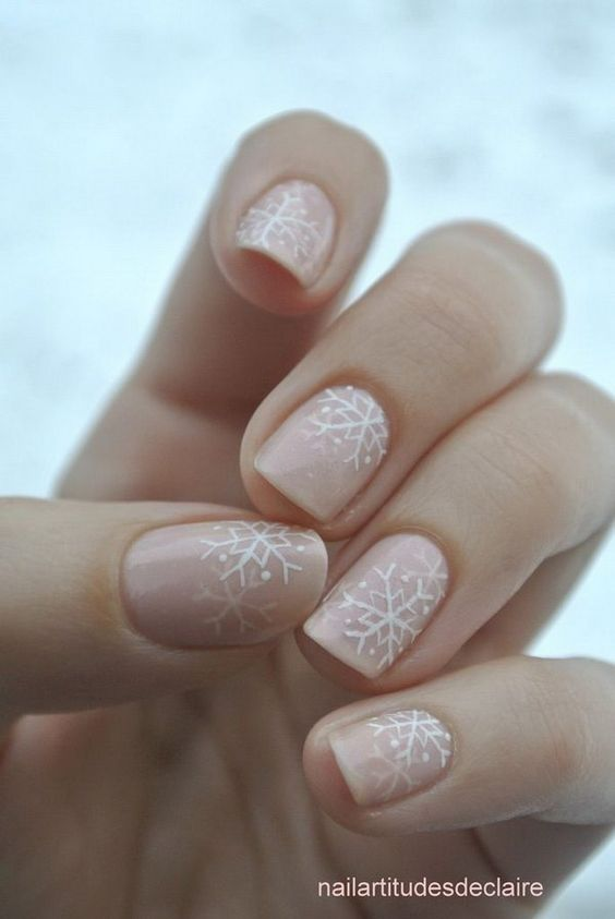 White Snowflakes on Pale Pink Nails.: