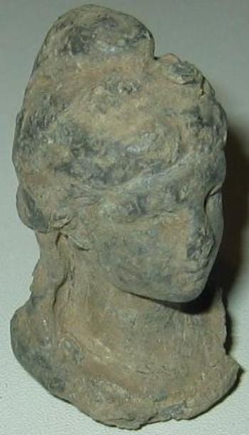 Tête de statuette en bronze face 2
