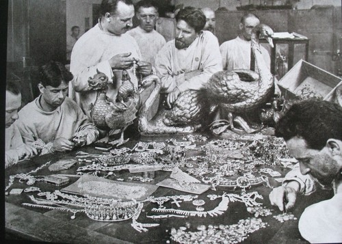 Photo of the treasures that were found by the Soviet Government in the Yusupov Palace in 1925. Standing in t he middle, leaning on an identical Fabergé swan, is Fedor Afanasiev, former head of the Fabergé jewellery department.  Source: T. Fabergé, E. Kohler, V. Skurlov (2012), Fabergé; A comprehensive Reference Book, Edition Slatkine, Geneva. p. 549.