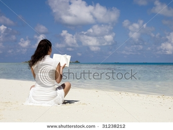 stock-photo-woman-reading-book-at-sandy-beach-31238212