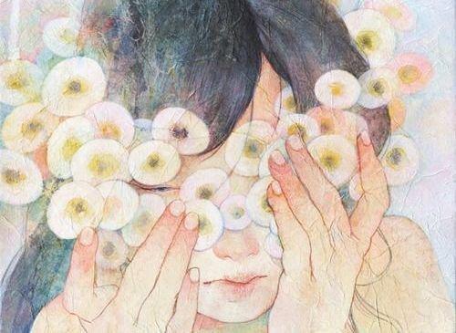 femme-avec-fleurs-rondes-sur-le-visage-500x365